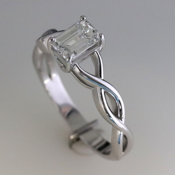 1 carat emerald cut diamond infinity engagement ring 2