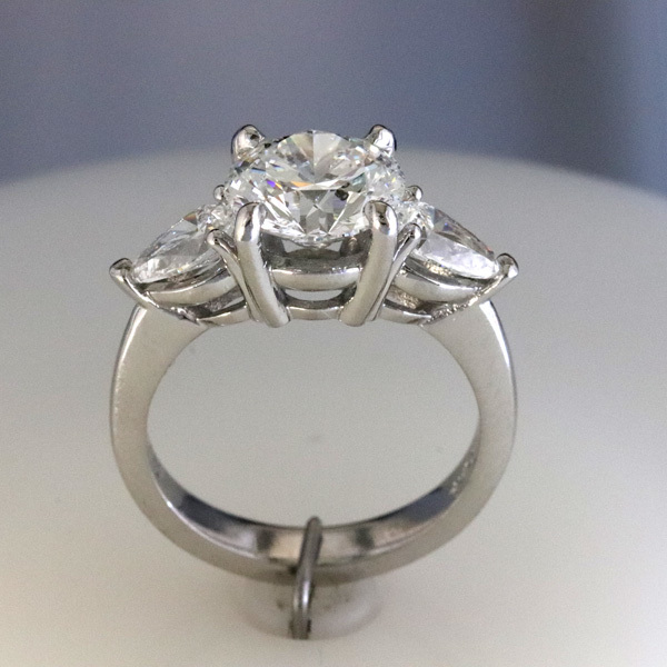 Engagement ring 2 carat round   pear shaped diamond sides 4