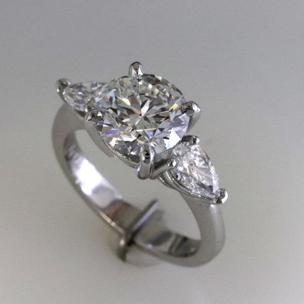 Engagement ring 2 carat round   pear shaped diamond sides 2