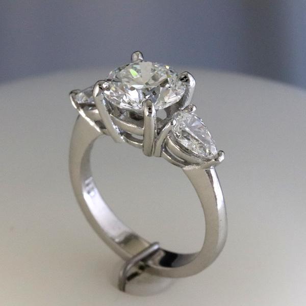 Engagement ring 2 carat round   pear shaped diamond sides 3