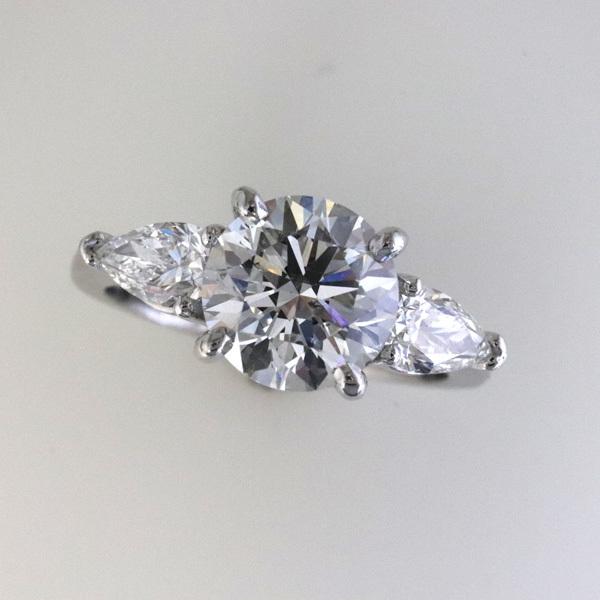Engagement ring 2 carat round   pear shaped diamond sides 1